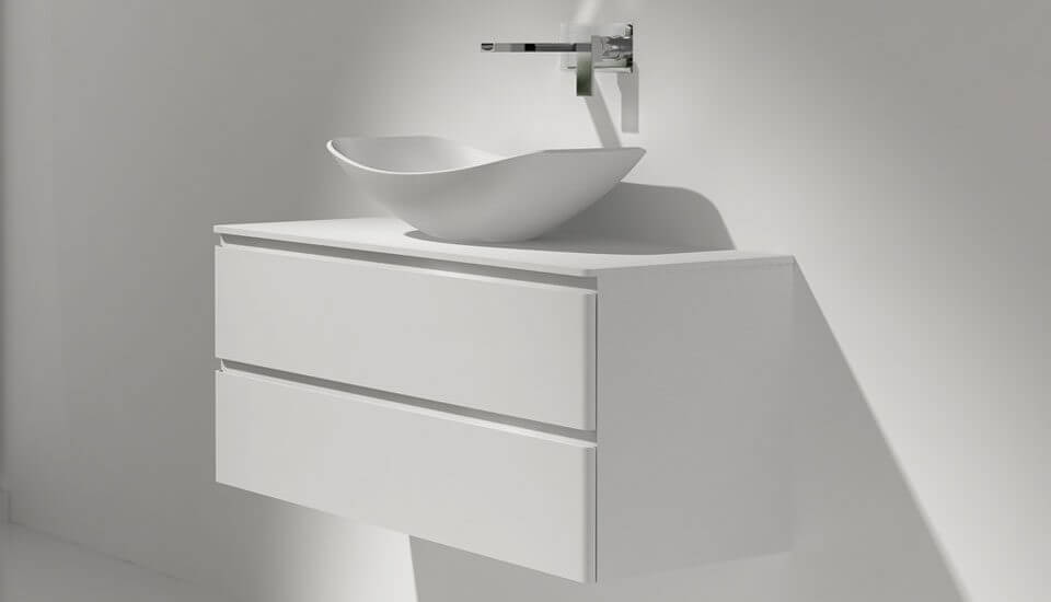 The hammock washing basin sits above the counter on a cabinet, this vessel sink design complements the hammock bath collection.
