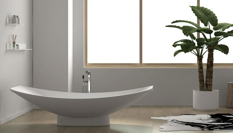 Mirage is Freestanding Hammock Bathtub supported by a skirting in a beautiful bathroom.